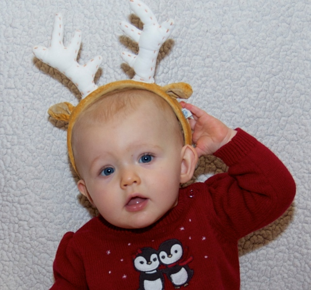 As soon as we put them on her head, she wants to rip them off!