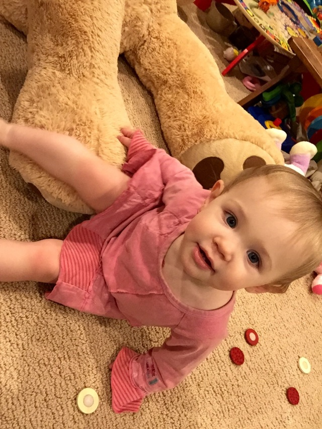 She loves her giant teddy bear!